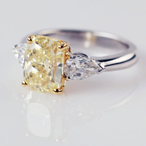 Emerald Cut Yellow Diamond With Pear Shaped Diamond Shoulders
