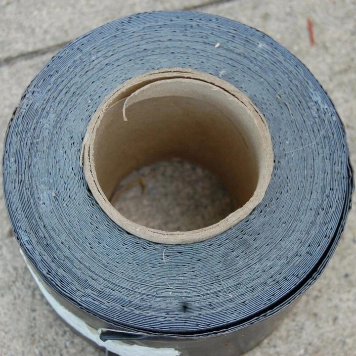 "75 ft roll of black rubber roof sealant tape 4"" wide, 30 Mils thick"