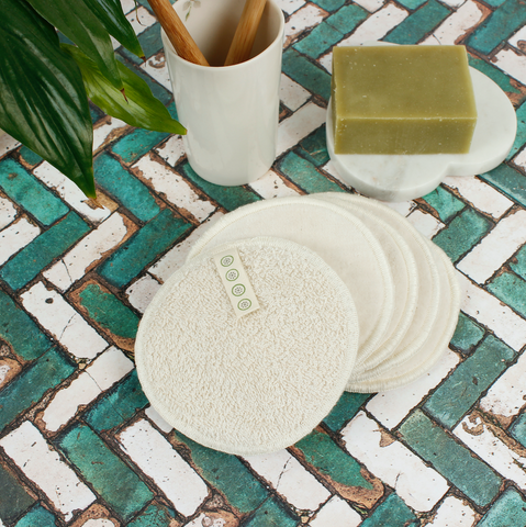 a slice of green 5 pack reusable cotton pads on surface