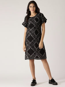 Signature Kesavi ruffle dress black with white