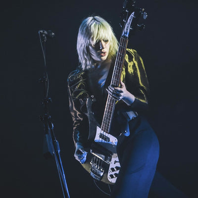 Julia Cumming from Sunflower Bean performing in Seattle with the Hip Strap waist guitar strap.