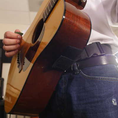 Velcro attachment on acoustic hip strap guitar strap