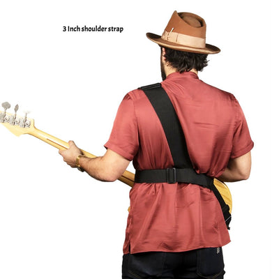 Rear view of Tyler playing bass with a 3 inch sling strap bass strap on left shoulder