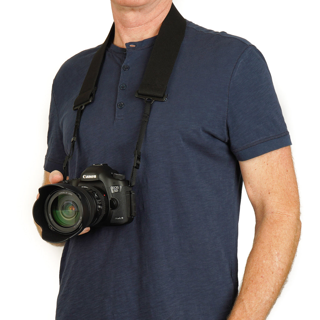 "Camera strap made of 2"" wide heavy-duty elastic material attached to a Canon camera"