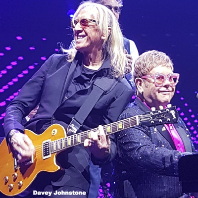 davey johnstone on stage with comfort stretch guitar strap and elton john