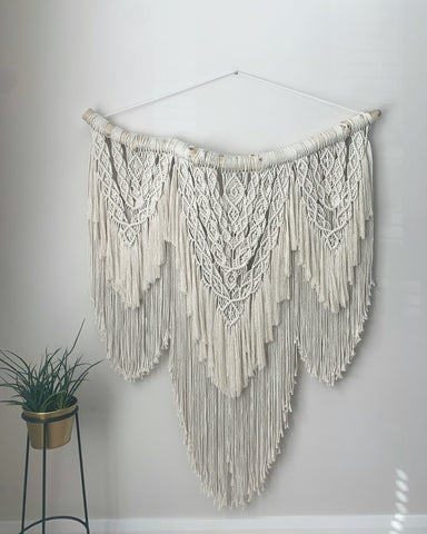 Large macramé wall hanging, handcrafted in Northern Ireland hung on driftwood foraged off our local coast .