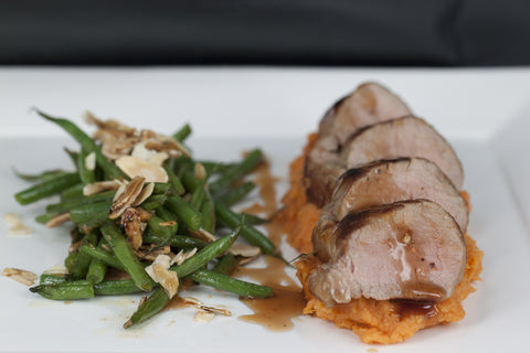 Pork Tenderloin with Sweet Potato Mash, French Beans and Cranberry Sauce