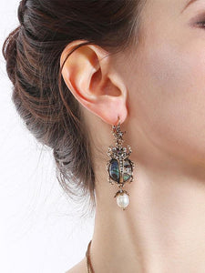 Bettle Juice Earrings With Pearl Star