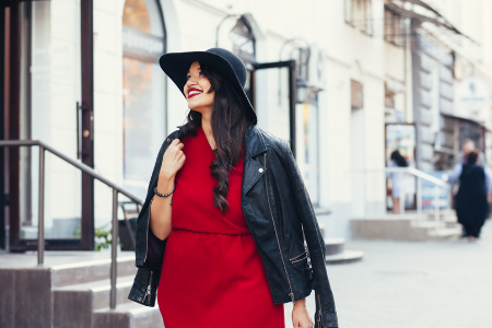 brunette plus sized model in red dress with leather jacket