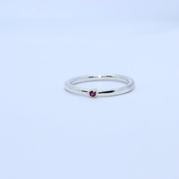 9ct white gold and ruby ring. - Sam Hawkins