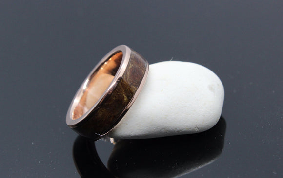 Rose gold lipped ring with an elm burl inlay. - Sam Hawkins