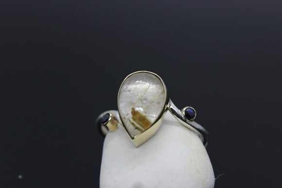 White Gold ring with a 12x8 Golden Rutile quartz centre stone with 2x2mm sapphires all set in a yellow gold setting - Sam Hawkins