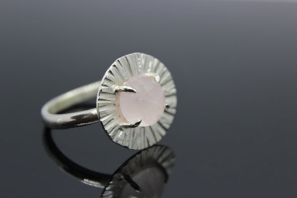 White Gold ring with a 8 mm rose quartz centre stone and patterned surrounding. - Sam Hawkins