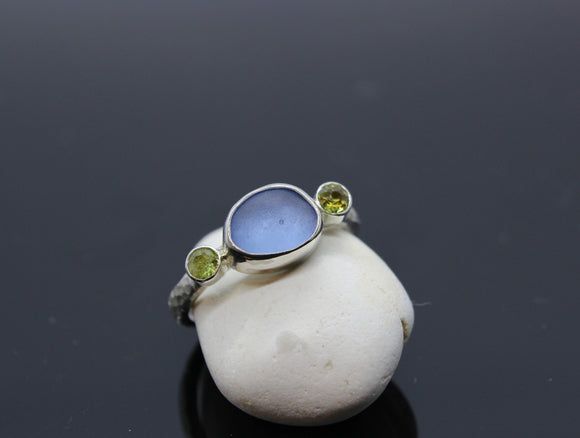 Hammered White Gold ring with a sea glass centre stone with 2x3mm peridots either side - Sam Hawkins