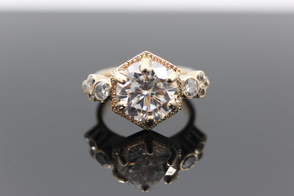 18 carat Gold ring with 8 diamonds surrounding a 10.1mm (4carat) moissanite. - Sam Hawkins
