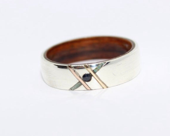 Silver ring with a rose gold, yellow gold, sapphire and turquoise inlay. - Sam Hawkins