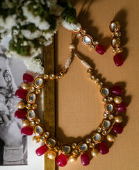 Kundan necklace with hand-painted Meena detail and hand-strung red stone drops