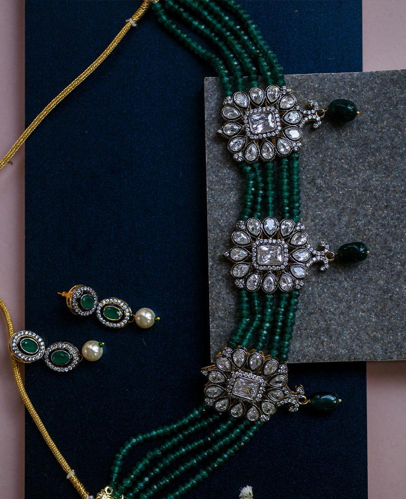 Crystal choker strung together with green quartz beads