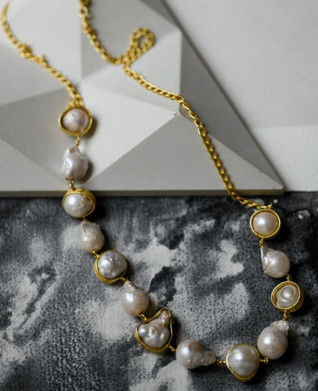Cased baroque pearls in a gold-toned necklace with half chain