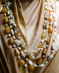 Gold-toned mother of pearl and semi-precious orange quartz mala