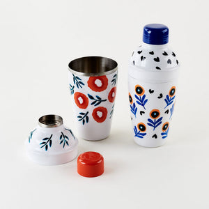 Two cocktail shakers each with a unique design of poppies handpainted on stainless steel