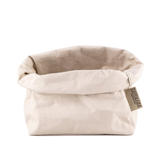 Rolled Uashmama paper bag in Cashmere  color.