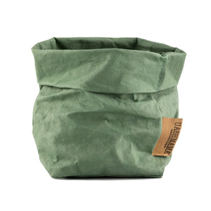 Partially rolled Uashmama paper bag in green Salvia color.