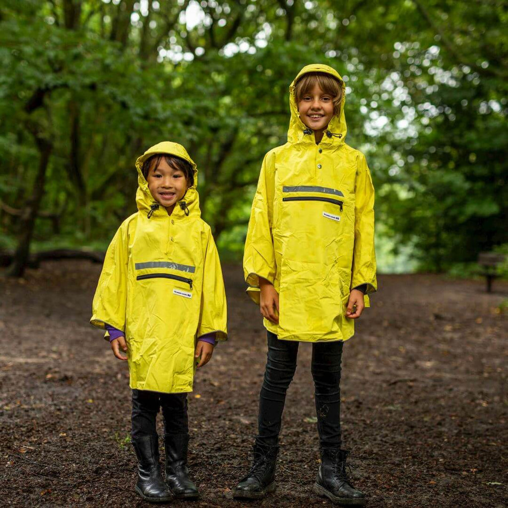Peoples Poncho yellow kind M - Olcay Belgium
