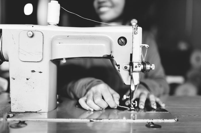 Outland denim seamstress at sewing machine