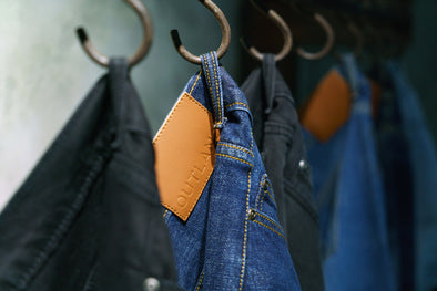 outland denim jeans hanging on hooks