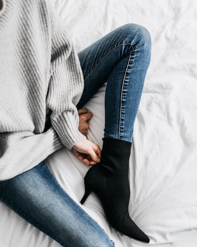 photo from above of woman wearing blue jeans and black boots