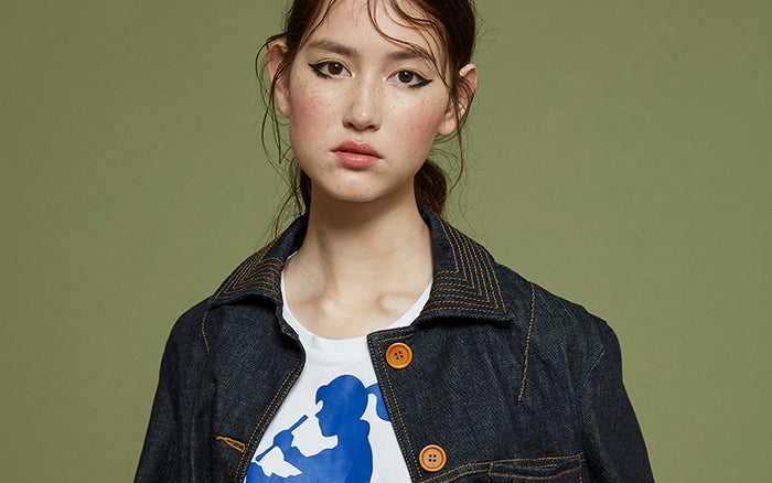 Woman wearing Outland Denim x Karen Walker collaboration Goldie jacket and Drummer Girl tee