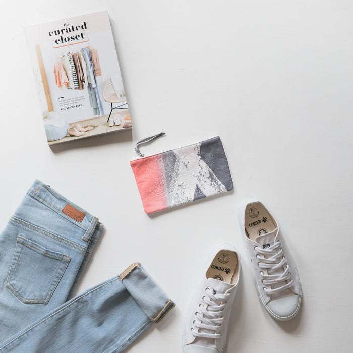 Flatlay of Etiko shoes and outland denim jeans