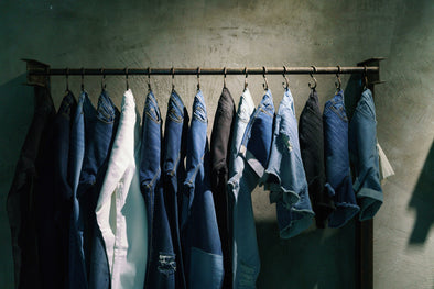 Outland Denim jeans hanging on clothes rack
