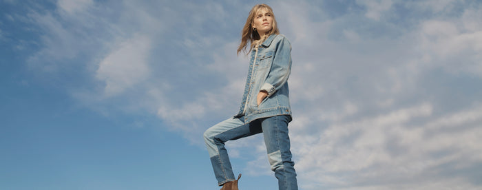Woman in front of blue sky wearing double denim