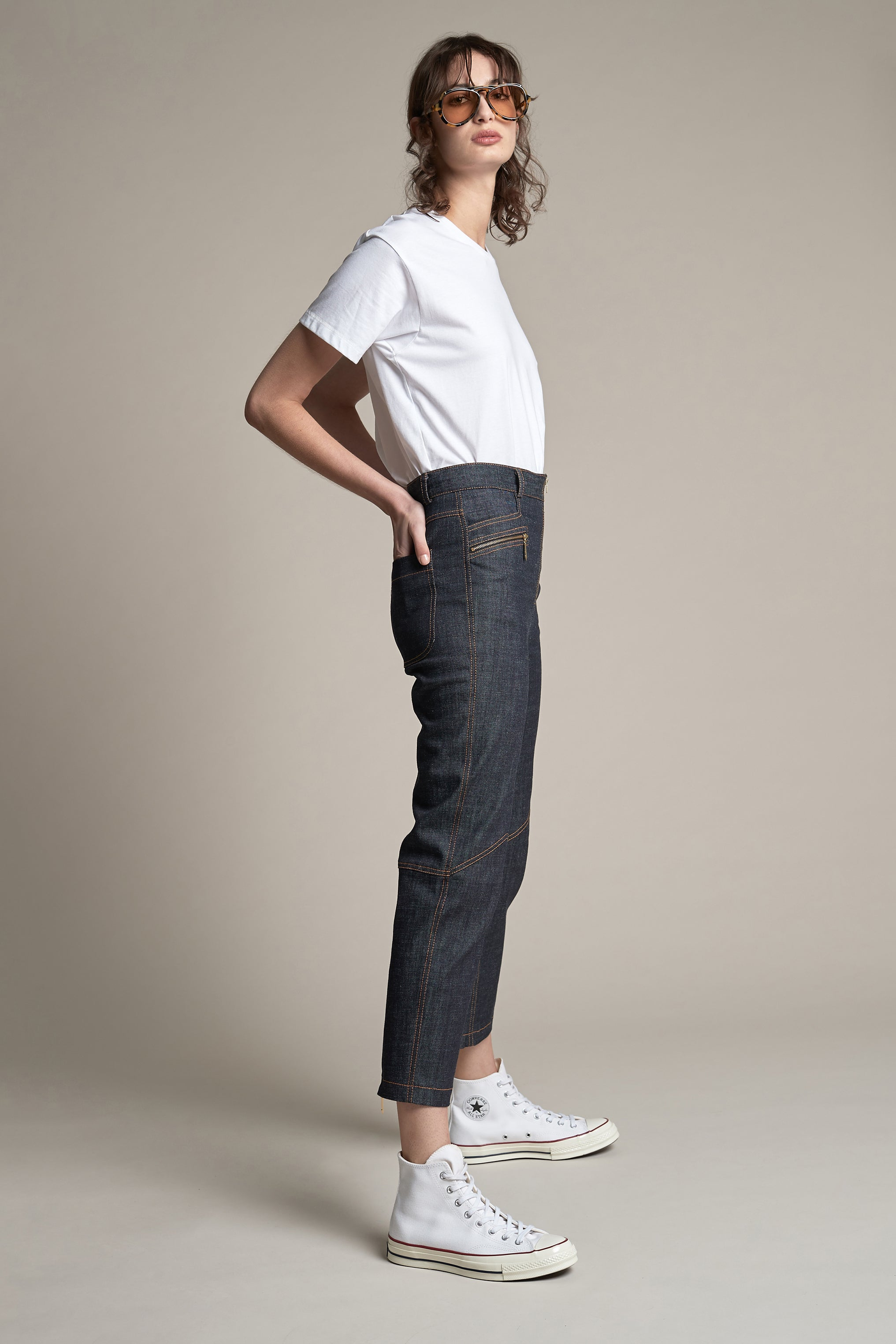 Woman wearing indigo Outland Denim x Karen Walker jeans