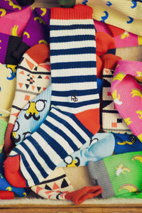 a selection of fun and witty performance socks so your fitness look can be as exciting as your life is.