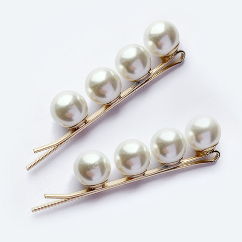 Pair of gold hair pins with a row of four pearls