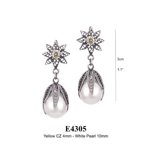 Tulip pearl drop earrings on flower post