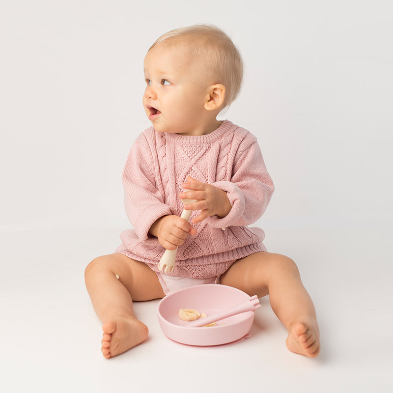 Les Enfants Silicon Baby Bowl and cutlery set pink and sand baby model looking to the side