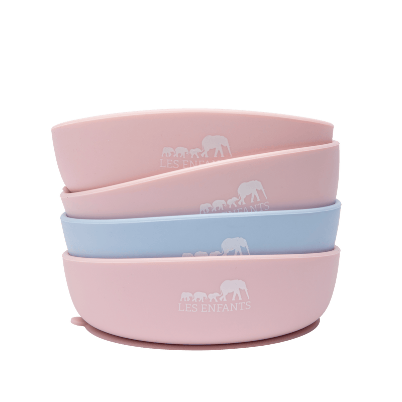 les enfants silicon bowl that sticks to surface eating collection pink several bowls stacked up