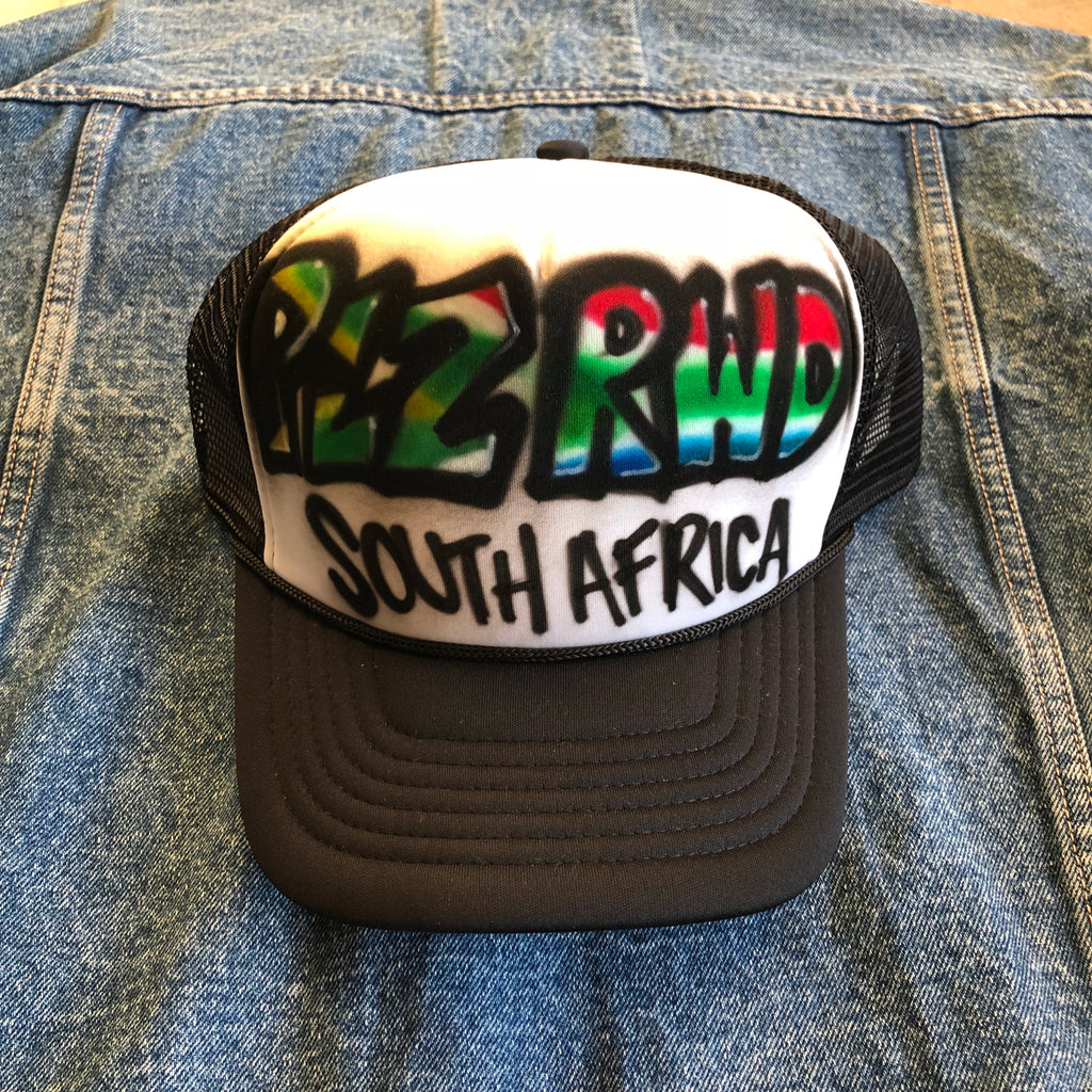 72f11aaa29680 PLZ RWD South Africa Airbrush Trucker Hat – PLZ RWD Tours