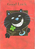 Good Luck Card - Grinning Black Cat Clutching Clover In Teeth