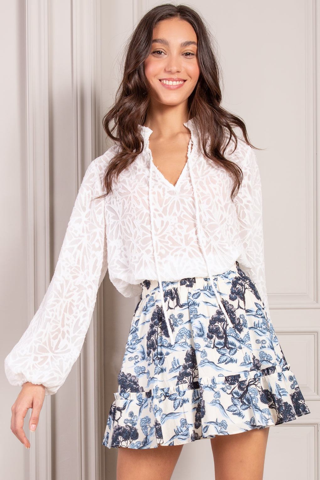 White Wildflower blouse with tie neck and long sleeves