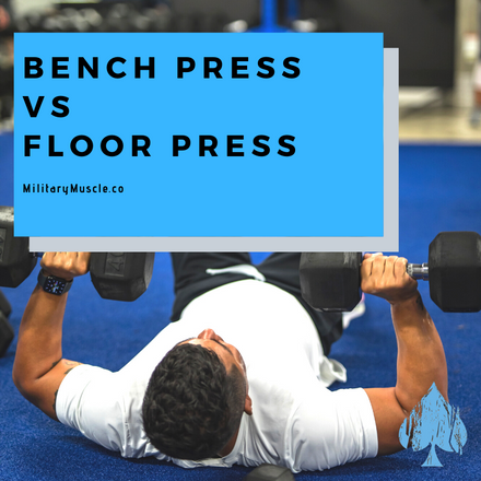 man doing floor press with dumbbells