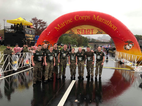 Military Muscle team members at the USMC marathon