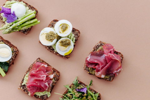 rye bread with meats, eggs and salad