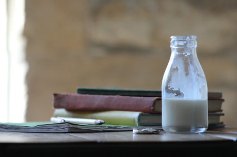 bottle of milk and books