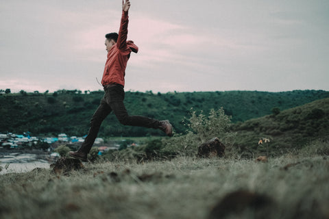 man leaping in countryside