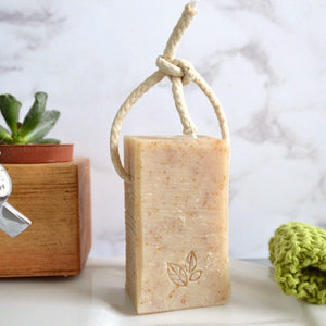 Unscented gentle oatmylk handmade vegan natural soap on a rope
